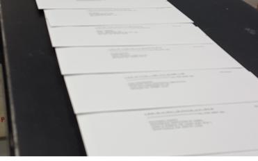Address printing process for bulk mailing at Black Tie Press