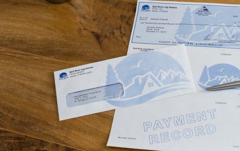 Custom printed envelope and busniness checks by Black Tie Press